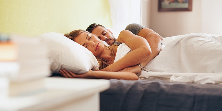 young couple sleeping peacefully. but the best cbd oil for sleep. buy cbd oil online USA.
